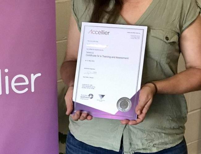 Cert IV TAE graduate holding a Certificate